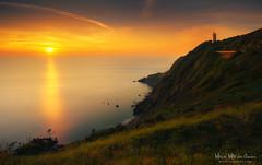Faro billano de Gorliz (Mimadeo) Tags: longexposure sunset sea sky lighthouse landscape evening coast spain rocks shoreline shore plentzia bizkaia gorliz euskadi vizcaya basquecountry paisvasco billano plencia villano clilff