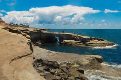 Playground (kirstenscamera) Tags: california ca blue sky people beach clouds outdoors coast nikon rocks air sunny cliffs palmtrees shore oceanbeach coastline ob below cave swimmers sunsetcliffs cliffjumpers