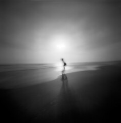 The moment we became a million trillion photons (Zeb Andrews) Tags: bw 6x6 film mediumformat landscape blackwhite pinhole figure pacificnorthwest handheld oregoncoast lensless analogphotography fortstevens ilfordfp4 realitysosubtle6x6