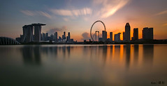 Singapore Skyline 2016 (long exposure) (Ken Goh thanks for 2 Million views) Tags: blue sunset sky sun reflection water silhouette skyline golden singapore pentax smooth sigma rays mode 1020 ff k1 citiscape marinabarrage gardenbythebay k5iis