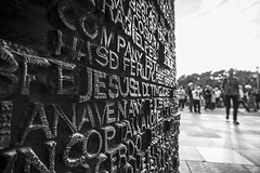 His Name On The Door (BoXed_FisH) Tags: barcelona travel people blackandwhite bw white black monochrome architecture grey mono spain europe dof bokeh sony streetphotography wideangle monotone depthoffield espana catalunya es sagradafamilia antonigaudi sonyalpha sonyzeiss zeiss1635 sonya7 sel1635z sony1635mmvariotessartfef4zaoss sonyzeiss1635f4oss