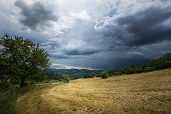 Countryside (LaPille) Tags: summer sky italy clouds contrast countryside italia cloudy fields umbria cloudysky sunbeams valfabbrica viafrancigena