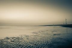 Moody Evening! (_Amritash_) Tags: longexposure travel light sunset sky blackandwhite india beach monochrome lights evening sand waves windmills lowtide mandvi beachscape cokin monochromemadness gujarattourism longexposurejunkie