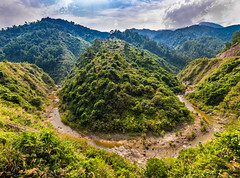 Along the Ho Chi Minh Highway (GeorgeABoyle) Tags: travel mountain mountains green nature beautiful clouds river landscape haze vietnam hazy hochiminhtrail hochiminhhighway