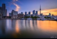 Toronto city sunrise (kelvinsei) Tags: city longexposure morning trees light summer toronto canada building water yellow skyline clouds sunrise boats cityscape cntower lakeshore