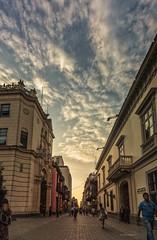 Lima y sus senderos coloniales (clandestinox21) Tags: street blue sunset sky urban peru yellow clouds canon buildings calle lima capital colonial perspective jesusguerrafotografia