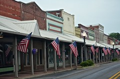 Downtown Hartselle, Alabama (deanrr) Tags: usa architecture buildings town mainstreet downtown outdoor flag alabama flags shops patriotism redwhiteblue morgancountyalabama hartsellealabama