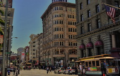 San Francisco Sunday (MPnormaleye) Tags: california city urban cars architecture composition america buildings shopping arch trolley gothic cities transportation utata cablecar shops historical hotels stores advertisements crowds brownstone frisco 1900s beauxarts