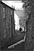 Walking the Dog . (wayman2011) Tags: street people urban bw dogs architecture buildings cumbria alston canon400d