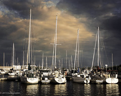 Sunset Marina (zuni48) Tags: sunset sky wisconsin clouds marina docks reflections boats harbor transportation mast nautical sailboats gününeniyisithebestofday blinkagain zunikoff