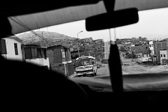 Driving in Villa El Salvador (David's_silvershots) Tags: poverty leica peru zeiss 35mm lima shanty fullframe m9 235 biogon villaelsalvador