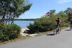 Cape Cod Rail Trail - Long Pond, Harwich (Massachusetts Office of Travel & Tourism) Tags: ma cycling waterfront capecod massachusetts americanflag trail biking capecodrailtrail