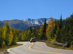 On the Road (Batikart) Tags: road street travel blue schnee autumn trees light vacation sky usa sun mountain holiday snow mountains green fall nature colors car yello
