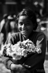 Portrait (Ashik Masud) Tags: poverty flowers girls portrait urban blackandwhite bw flower girl smile smiling festival seas