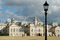 View of Horse Guards Parade, Whitehall, with the London Eye in the distance, London, England (Roberto Herrett) Tags: city uk travel light england sky people urban white storm london english tourism k horizontal architecture clouds buildings dark outside europe icons unitedkingdom britain streetlamp famous capital sightseeing cities dramatic londoneye stormy places tourist architectural historic lamppost u historical british lit iconic figures sights attractions locations courtyards stockphoto exteriors rherrettflk