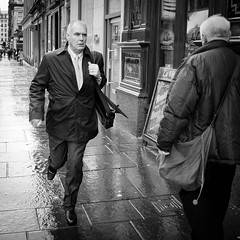 Running Man (Leanne Boulton) Tags: life lighting street city uk windows light portrait people urban blackandwhite bw white man motion black detail reflection male texture wet monochrome face smart shop businessman modern contrast canon reflections bag square point mono scotland living blackwhite store high movement focus shiny energy dress angle pavement expression glasgow candid wide working formal tie pedestrian running run scene suit sidewalk human shade crop portraiture paving late worker format bandw flapping vanishing footpath tone facial appointment attire vision:people=099 vision:face=099 vision:outdoor=0722
