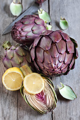 Raw artichokes (Speleolog) Tags: life wood two food brown white color green cooking vegetables vertical horizontal season french table still healthy italian raw purple shot heart eating no group objects crop backgrounds organic thorn heap section artichoke freshness ingredient dietary