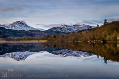 Ben Lomond reflected in Loch Ard (GenerationX) Tags: trees winter snow mountains water reflections mirror scotland still unitedkingdom calm hills loch boathouse benlomond lochard beinndubh kinlochard