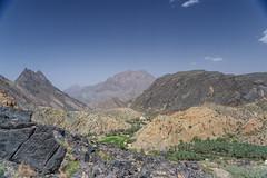 Overlooking Az Zammah (Sutha_Siva) Tags: 4x4 bluesky canyon hills landscape oman rocklayers rockylandscape rurallife wadibaniawf