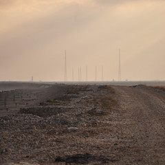DSC_1261 [ps] - Array/Dis (Anyhoo) Tags: uk winter sea england mist tower beach water coast suffolk haze waves horizon shingle spray coastal shore masts aldeburgh crepuscularrays aerials lowsun orfordness slaughden anyhoo photobyanyhoo