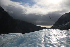 Left behind (alideniese) Tags: newzealand sky cloud sun mountains cold ice landscape outdoors chopper shiny moody glacier helicopter nz franzjosefglacier southisland franzjosef westlandtaipoutininationalpark