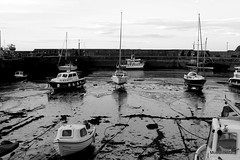 Tide is out (mootzie) Tags: seaweed monochrome out boats sand aberdeenshire tide sails ropes nautical knots stonehaven