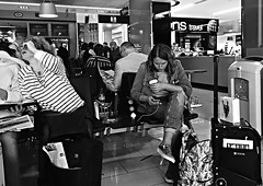 Waiting to fly (Eric_G73) Tags: street travel people blackandwhite bw london girl airport candid streetphotography londoncityairport candidphotography lcy