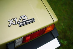 """X1/9 five speed"" (Eric Flexyourhead (shoulder injury, slow)) Tags: canada detail car zeiss italian bc fiat britishcolumbia badge northvancouver fragment waterfrontpark shallowdepthoffield 2016 embelm fiatx19 x19 fivespeed 55mmf18 italianfrenchcarbikefestival sonyalphaa7 zeisssonnartfe55mmf18za"