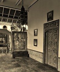 portrait of a king (SM Tham) Tags: portrait bali building lamp monochrome sepia indonesia island mirror asia doors furniture entrance photographs porch lantern verandah dresser royalpalace karangasem amlapura puriagungkarangasem maskerdam
