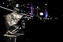 Night shift (takeaphotoitwilllastforever) Tags: street city night dark lights evening neon sitting break sydney vivid quay sit rest performer circular