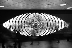 Eye see (Elios.k) Tags: horizontal indoors people many men women woman center heels walk walking interior train station commuting commuters shinjuku shinjukueye miyashitayoshiko artwork art wall eye giant moving movement motion blur rush hour bw blackandwhite monochrome night travel travelling november 2015 vacation canon 5dmkii camera photography tokyo city kantregion kanto tokyometropolis honsu asia japan