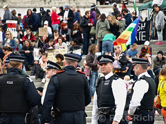 P5045443 (pete riches) Tags: uk london westminster protest trafalgarsquare police flags demonstration banners anonymous whitehall slogans placards tsg metpolice austerity occupy territorialsupportgroup spendingcuts vmasks peteriches occupylondon wearethe99 anonymousmasks vforvictorymasks