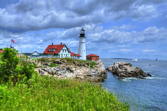 Portland Head Light Lighthouse [EXPLORE] (Moniza*) Tags: ocean park light usa lighthouse seascape water sailboat portland landscape bay harbor boat sand nikon rocks head maine explore national sail capeelizabeth gulfofmaine cascobay d90 portlandharbor explored moniza