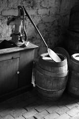 Beer Barrels (peterkelly) Tags: bw ontario canada brick water beer stone wall digital floor sink hamilton barrel basement pump northamerica making dundurncastle dundurnnationalhistoricsite