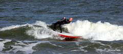 Mr Flexible (mootzie) Tags: red white beach scotland waves surfer paddle surfing aberdeen surfboard balance wetsuit