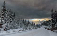 Rise above the storm and you will find the sunshine . (Josiane .) Tags: trees winter snow canada storm mountains nature clouds nationalpark nikon roads cans2s vision:mountain=085 vision:sunset=051 vision:sky=