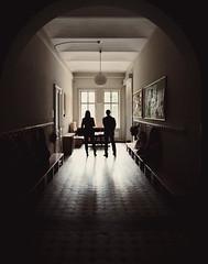 Window Watcher (CoolMcFlash) Tags: old school light two people woman man reflection window lamp silhouette photography lampe licht fotografie alt fenster gang fujifilm mann frau reflexion zwei schule reflektion personen gangway x10 umris kontur
