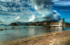 The magnificent sky of Corfu (Geri Grudeva) Tags: camera wood travel blue light sea sky orange plants cloud white mountain plant flower green art beach church nature water beautiful yellow stone glitter club clouds digital canon landscape lights spring fantastic sand glow power photos stones radiance decoration greece dslr corfu unlimited thelightfantastic greatphotographers digitalcameraclub travellandscape beautifulcapture hairygits abigfave beautifulexposure powerofart oldandbeautiful flickrdiamond unlimitedphotos hairygitselite mygearandme infinitexposure