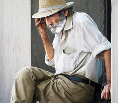 Poor but not begging (chrisk8800) Tags: barcelona life street old city portrait people urban man face hat beard lumix photography spain serious candid poor thoughtful straw stranger panasonic pensive g6