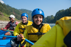 Trisuli rafting (Alex Treadway) Tags: travel trees nepal hardhat people woman holiday man motion nature wet water smiling sport danger forest river fun outside togetherness boat dangerous asia whitewater day waves risk faces joy paddle floating happiness tourists rapids adventure equipment rafting inflatable valley transportation rowing leisure flowing extremesports activity excitement paddling vacations challenge himalayas lifejacket dinghy whitewaterrafting drifting cooperation courage teamwork oars watersport headwear exhilaration adventurous rivertrip traveldestinations physicalactivity menandwomen oarboat safetyhelmet outdoorpursuit trisuli indiansubcontinent recreationalpursuit floatingonwater nauticalvessel trisuliriver