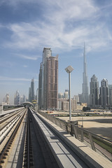 The City (oilyragg) Tags: city lines station clouds buildings long exposure dubai metro tube tram rail railway trains landmark khalifa burj