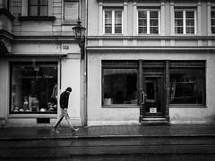 Feel the Rain (Sandy...J) Tags: street city urban bw white man black rain germany walking bayern deutschland photography mono blackwhite fotografie walk streetphotography olympus stadt sw mann monochrom oldtown regen bavarian gehen spazieren schwarzweis strasenfotografie