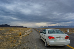 Somewhere along the route, I found heaven. (lone_krusader) Tags: road travel blue pakistan red sky mountain beautiful car rain clouds photoshop lights photo nikon heaven route adobe enjoy lado toyota corolla lightroom memorable 2016 quetta faisalabad xli d5200