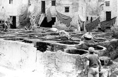 A Fes tannery, Morocco 1984 (Juha Riissanen) Tags: old bw men pits working experiment morocco fez brickwalls walls rough fes tannery hides