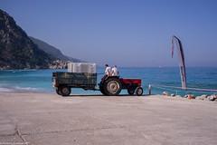 Beach boys (aleksey_kondratiev) Tags: turkey fethiye oludeniz mediterranean sea water blue wave waves seashore rocks sky mountain beachboys tractor trailer flag