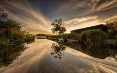 At the lake (Stefan Sellmer) Tags: longexposure blue sunset sky lake color tree green nature clouds germany de boats deutschland colorful outdoor kiel schleswigholstein strande fuhlensee