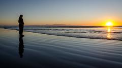 Oreti Beach reflections (Kathrin & Stefan) Tags: ocean sunset newzealand sky reflection beach nature silhouette backlight island sand outdoor southisland tasmansea nzl invercargill rakiura stewartisland foveauxstrait oretibeach kathrinmarks