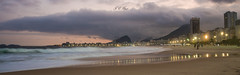 Sunset Cloudy in Rio de Janeiro (Jos Eduardo Nucci) Tags: ocean winter sunset sky people panorama seascape color reflection love beach nature brasil riodejaneiro season photography lights evening photo waves cloudy outdoor neighborhood copacabana solstice positive carioca leme olympicgames vibe wonderfulcity