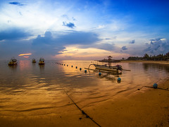 Liquid Gold2 (erikjnainggolan) Tags: sunrise sunset sun rays light beach sea ocean seascape bali indonesia boat golden sky skies cloud clouds olympus omd