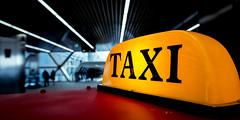 Taxi (Sean Batten) Tags: taxi sign canarywharf adamsplace london england unitedkingdom gb eastlondon nikon d800 1424 yellow red city urban crossrailplace